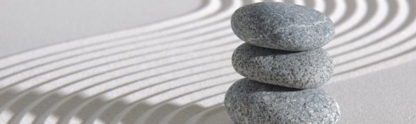 Smooth stones stacked in Zen raked garden
